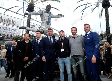 Cobi Jone,left, Robbie Keane, second from left, David Beckham, third from left, Chris Klein, right pose with the newly unveiled statue of former Los Angeles Galaxy midfielder David Beckham at Legends Plaza in front of Dignity Health Sports Park in Carson, Calif