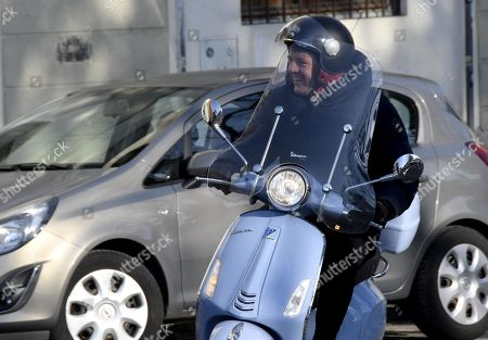 Former Italian Prime Minister Matteo Renzi uses a motor scooter to ride to the voting in the primary elections for the national secretariat of the Italian Democratic Party (Partito Democratico, PD), in Florence, Italy, 03 March 2019. PD politicians Maurizio Martina, who replaced Renzi following his resignation in 2018, Roberto Giachetti and Nicola Zingaretti are the main candidates for the Democratic Party's leadership election which was triggered by the party's general election defeat and Renzi's withdrawal in 2018.