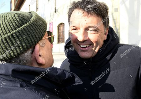 Former Italian Prime Minister Matteo Renzi (R) is greeted by a supporter as he arrives for the primary elections for the national secretariat of the Italian Democratic Party (Partito Democratico, PD), in Florence, Italy, 03 March 2019. PD politicians Maurizio Martina, who replaced Renzi following his resignation in 2018, Roberto Giachetti and Nicola Zingaretti are the main candidates for the Democratic Party's leadership election which was triggered by the party's general election defeat and Renzi's withdrawal in 2018.