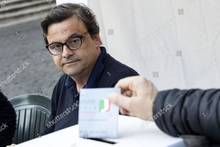 Former Italian Economic Development Minister Carlo Calenda watches a voter casting his ballot during the primary elections for the national secretariat of the Italian Democratic Party (Partito Democratico, PD), in Rome, Italy, 03 March 2019. PD politicians Maurizio Martina, who replaced Renzi following his resignation in 2018, Roberto Giachetti and Nicola Zingaretti are the main candidates for the Democratic Party's leadership election which was triggered by the party's general election defeat and Renzi's withdrawal in 2018.