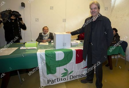 Former Italian Prime Minister Paolo Gentiloni (front) casts his ballot during the primary elections for the national secretariat of the Italian Democratic Party (Partito Democratico, PD), in Rome, Italy, 03 March 2019. PD politicians Maurizio Martina, who replaced Renzi following his resignation in 2018, Roberto Giachetti and Nicola Zingaretti are the main candidates for the Democratic Party's leadership election which was triggered by the party's general election defeat and Renzi's withdrawal in 2018.