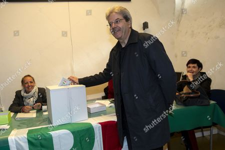 Former Italian Prime Minister Paolo Gentiloni (C) casts his ballot during the primary elections for the national secretariat of the Italian Democratic Party (Partito Democratico, PD), in Rome, Italy, 03 March 2019. PD politicians Maurizio Martina, who replaced Renzi following his resignation in 2018, Roberto Giachetti and Nicola Zingaretti are the main candidates for the Democratic Party's leadership election which was triggered by the party's general election defeat and Renzi's withdrawal in 2018.