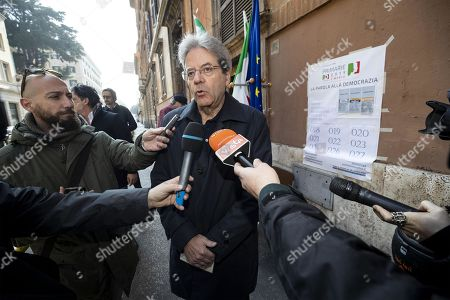Former Italian Prime Minister Paolo Gentiloni (C) speaks with journalists after casting his ballot during the primary elections for the national secretariat of the Italian Democratic Party (Partito Democratico, PD), in Rome, Italy, 03 March 2019. PD politicians Maurizio Martina, who replaced Renzi following his resignation in 2018, Roberto Giachetti and Nicola Zingaretti are the main candidates for the Democratic Party's leadership election which was triggered by the party's general election defeat and Renzi's withdrawal in 2018.