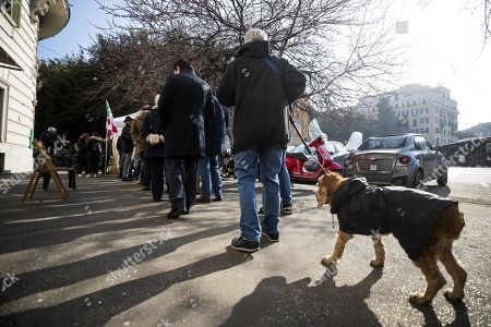 A man is accompanied by his pet dog as they queue to vote in the primary elections for the national secreteriat of the Italian Democratic Party (Partito Democratico, PD), at a tent in Rome, Italy, 03 March 2019. PD politicians Maurizio Martina, who replaced Renzi following his resignation in 2018, Roberto Giachetti and Nicola Zingaretti are the main candidates for the Democratic Party's leadership election which was triggered by the party's general election defeat and Renzi's withdrawal in 2018.