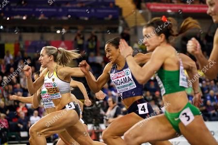 Cindy Roleder of Germany, left, competes in a semifinal of the women's 60 meters hurdles race at the European Athletics Indoor Championships at the Emirates Arena in Glasgow, Scotland