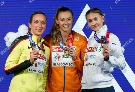 Silver medalist Cindy Roleder of Germany, gold medalist Nadine Visser of the Netherlands and Elvira Herman of Belarus, from left to right, pose on the podium of the women's 60 meters hurdles race final at the European Athletics Indoor Championships at the Emirates Arena in Glasgow, Scotland