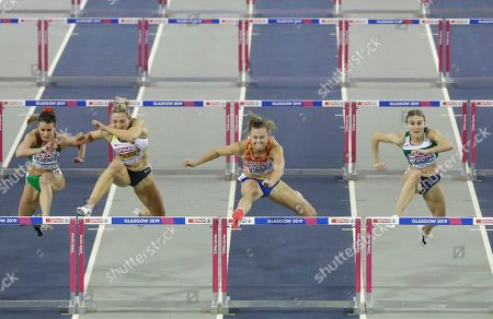 Netherlands' Nadine Visser, 2nd right, competes to win the women's 60 meters hurdles race final ahead of Hungary's Greta Kerekes, left, Germany's Cindy Roleder, 2nd left, and Belarus' Elvira Herman, right, during the European Athletics Indoor Championships at the Emirates Arena in Glasgow, Scotland
