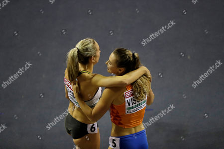 Netherlands' gold medalist Nadine Visser, right, hugs with Germany's silver medalist Cindy Roleder, left, after the women's 60 meters hurdles race final during the European Athletics Indoor Championships at the Emirates Arena in Glasgow, Scotland