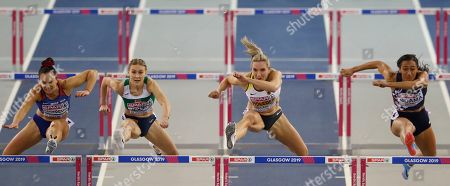 Croatia's Andrea Ivancevic, left, Belarus' Elvira Herman, 2nd left, Germany's Cindy Roleder, 2nd right, and France's Solene Ndama, right, compete in a semifinal of the women's 60 meters hurdles race during the European Athletics Indoor Championships at the Emirates Arena in Glasgow, Scotland