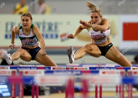 Elvira Herman (L) of Belarus and Cindy Roleder of Germany compete in the women's 60m hurdles semifinal at the 35th European Athletics Indoor Championships, Glasgow, Britain, 03 March 2019.