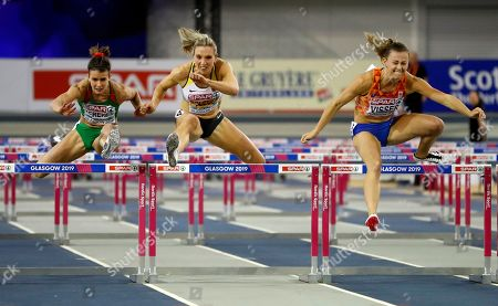 Nadine Visser (R) of the Netherlands, Cindy Roleder (C) of Germany and Greta Kerekes of Hungary compete in the women's 60m hurdles final at the 35th European Athletics Indoor Championships, Glasgow, Britain, 03 March 2019.