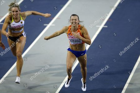 Stock Image of Nadine Visser (R) of the Netherlands and Cindy Roleder of Germany compete in the women's 60m hurdles final at the 35th European Athletics Indoor Championships, Glasgow, Britain, 03 March 2019.