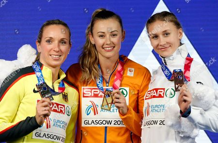 Gold medalist Nadine Visser (C) of the Netherlands poses with silver medalist Cindy Roleder (L) of Germany and bronze medalist Elvira Herman of Belarus in the medal ceremony for the women's 60m hurdles final at the 35th European Athletics Indoor Championships, Glasgow, Britain, 03 March 2019.