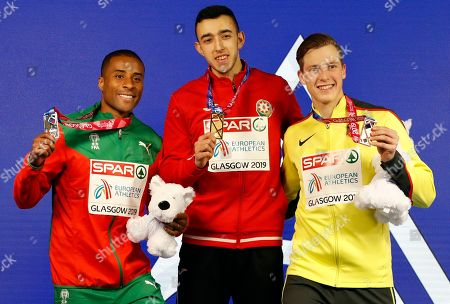 (L-R) Silver medalist Nelson Evora of Portugal, gold medalist Nazim Babayev of Azerbaijan and bronze medalist Max Hess of Germany pose for pictures during the medal ceremony in the men's triple jump at the 35th European Athletics Indoor Championships, Glasgow, Britain, 03 March 2019.