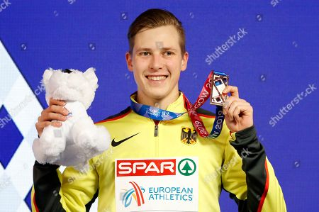 Bronze medalist Max Hess of Germany poses for pictures during the medal ceremony in the men's triple jump at the 35th European Athletics Indoor Championships, Glasgow, Britain, 03 March 2019.