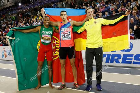 (L-R) Silver medalist Nelson Evora of Portugal, gold medalist Nazim Babayev of Azerbaijan and bronze medalist Max Hess of Germany pose for pictures in the men's triple jump at the 35th European Athletics Indoor Championships, Glasgow, Britain, 03 March 2019.
