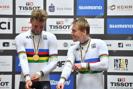 Roger Kluge and Theo Reinhardt of Germany celebrate winning the Men's Madison Final wearing The Rainbow Jerseys on the Podium.