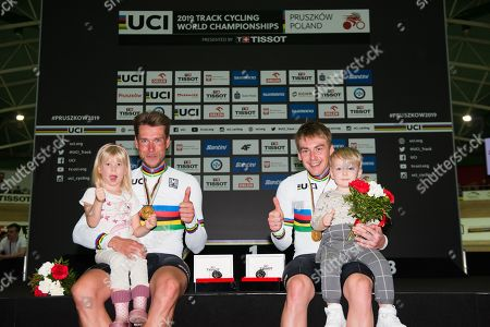 Roger Kluge and Theo Reinhardt of Germany celebrate winning the Men's Madison Final with their children.
