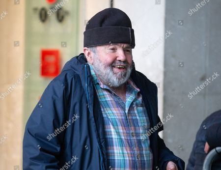 Comedian, Andy Hamilton, arrives  at the BBC Studios, London.