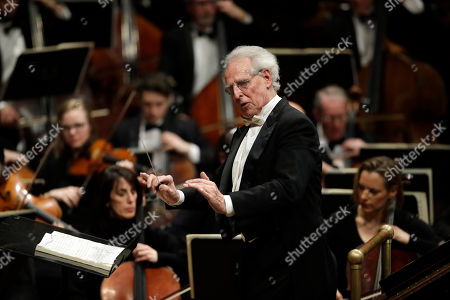 Stock Image of Benjamin Zander conducts the Boston Philharmonic Orchestra at the Sanders Theatre in Cambridge, Mass. The internationally acclaimed conductor, who approaches his 80th birthday on March 9, has spent half his life leading the Boston Philharmonic Orchestra, which he founded in 1979