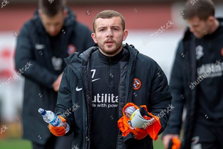 Paul McMullan (#7) of Dundee United FC makes his way to the dugout before the William Hill Scottish Cup quarter final match between Dundee United and Inverness CT at Tannadice Park, Dundee