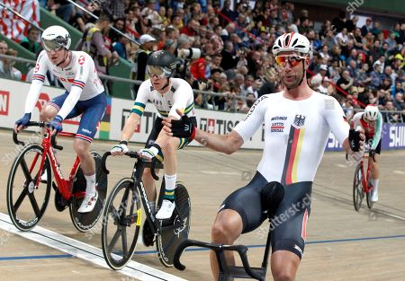 Germany's Roger Kluge, right, celebrates after winning the Men's Madison final race 50 km during the UCI Track Cycling World Championship in Pruszkow, Poland