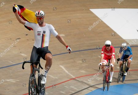 Germany's Roger Kluge, left, celebrates after winning the Men's Madison final race 50 km during the UCI Track Cycling World Championship in Pruszkow, Poland