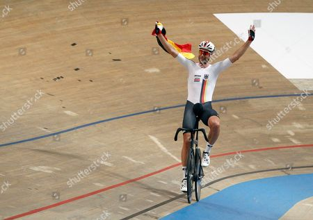 Germany's Roger Kluge celebrates after winning the Men's Madison final race 50 km during the UCI Track Cycling World Championship in Pruszkow, Poland
