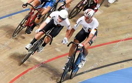 Roger Kluge (R) and Theo Reinhardt (L) of Germany compete in the men's Madison final of the UCI Track Cycling World Championships 2019 at the Velodrome BGZ Arena in Pruszkow, Poland, 03 March 2019. Kluge and Reinhardt won the gold medal.