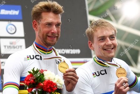 Stock Picture of Roger Kluge (L) and Theo Reinhardt (R) of Germany pose with their gold medals on the podium after winning the men's Madison final of the UCI Track Cycling World Championships 2019 at the Velodrome BGZ Arena in Pruszkow, Poland, 03 March 2019.