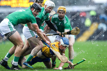 Stock Image of Clare vs Limerick. Limerick's Tom Morrissey, Paddy O'Loughlin and Tom Conlon with Jack Browne of Clare
