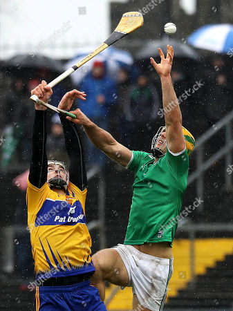 Clare vs Limerick. Clare's Peter Duggan and Dan Morrissey of Limerick