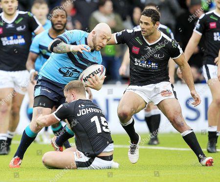 Widnes's Jordan Johnson   tackles Featherstone's John Davies