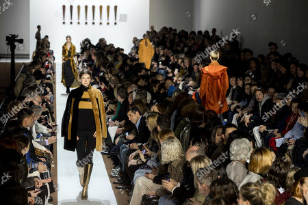 Stock Photo of A model presents a creation from the Fall/Winter 2019/20 Women collection by Swiss designer Albert Kriemler for Akris fashion house during the Paris Fashion Week, in Paris, France, 03 March 2019. The presentation of the Women's collections runs from 25 February to 05 March.