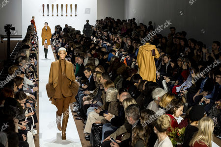 Stock Image of A model presents a creation from the Fall/Winter 2019/20 Women collection by Swiss designer Albert Kriemler for Akris fashion house during the Paris Fashion Week, in Paris, France, 03 March 2019. The presentation of the Women's collections runs from 25 February to 05 March.