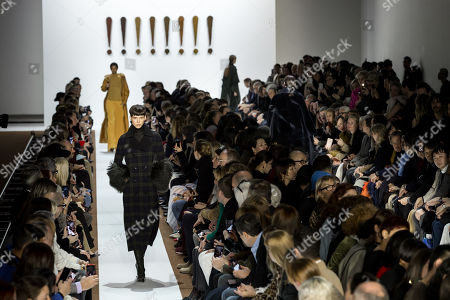 A model presents a creation from the Fall/Winter 2019/20 Women collection by Swiss designer Albert Kriemler for Akris fashion house during the Paris Fashion Week, in Paris, France, 03 March 2019. The presentation of the Women's collections runs from 25 February to 05 March.