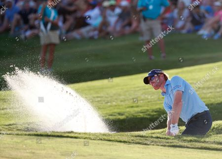 Roberto Castro hits out of a bunker on the 18th hole during the final round of the Honda Classic golf tournament, in Palm Beach Gardens, Fla