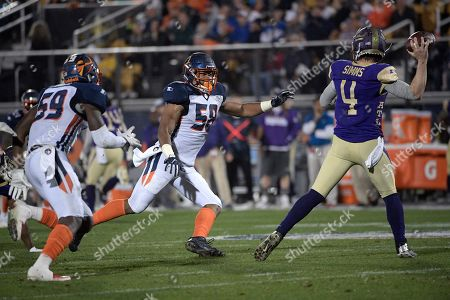 Orlando Apollos linebackers Earl Okine (59) and Christian French (58) pressure Atlanta Legends quarterback Matt Simms (4) during the first half of an AAF football game, in Orlando, Fla