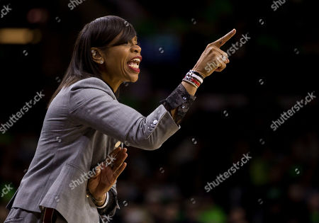 Virginia head coach Tina Thompson yells to her players during the first half of an NCAA college basketball game against Notre Dame, in South Bend, Ind