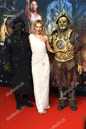 Julia Dietze (C) poses with movie characters as she arrives for the premiere of the movie 'Iron Sky: The Coming Race' in Berlin, Germany, 03 March 2019. The movie 'Iron Sky: The Coming Race' will screen from 21 March 2019 in German cinemas.