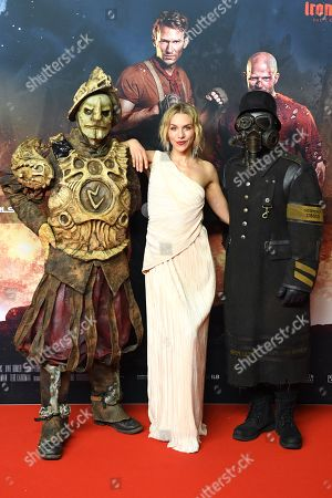 Stock Picture of Julia Dietze (C) poses with movie characters as she arrives for the premiere of the movie 'Iron Sky: The Coming Race' in Berlin, Germany, 03 March 2019. The movie 'Iron Sky: The Coming Race' will screen from 21 March 2019 in German cinemas.