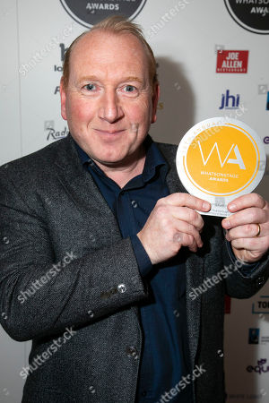 Adrian Scarborough accepts the award for Best Supporting Actor in a Play