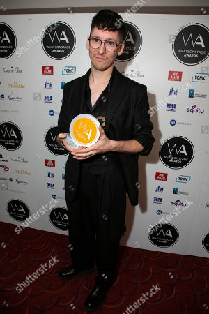 Tom Scutt accepts the award for Best Set Design