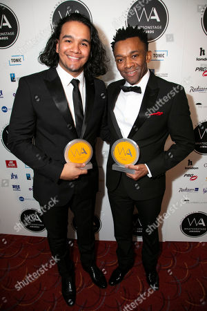 Stock Image of Cleve September accepts the award for Best Lighting Design on behalf of Howell Binkley and Jason Pennycooke accepts the award for Best Supporting Actor in a Musical