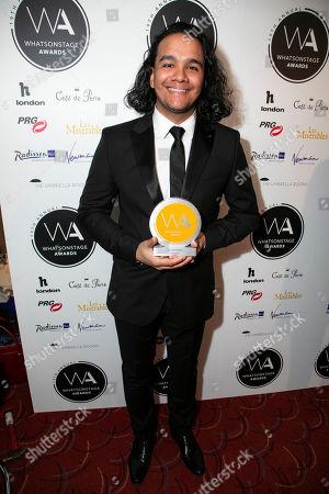 Cleve September accepts the award for Best Lighting Design on behalf of Howell Binkley