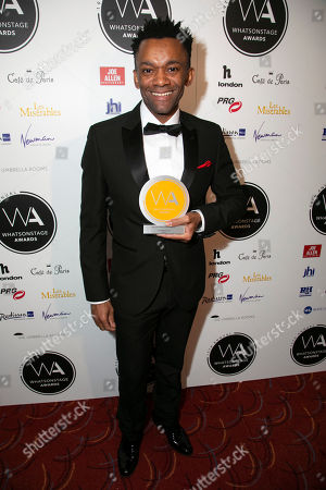 Jason Pennycooke accepts the award for Best Supporting Actor in a Musical