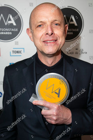 Simon Williams accepts the award for Best Show Poster
