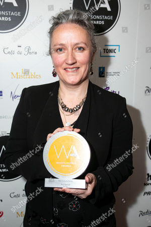 Claire Murphy accepts the award for Best Costume Design on behalf of Paul Tazewell