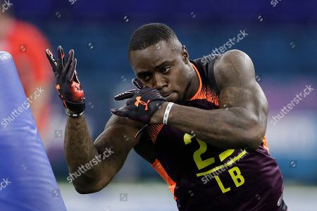Texas linebacker Gary Johnson runs a drill during the NFL football scouting combine, in Indianapolis
