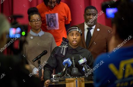Stevante Clark, the brother of Stephon Clark who was killed by police last year, speaks during a news conference at the Genesis Church in Sacramento, Calif., . Standing behind Clark are National Action Network representative Margaret Fortune, left, Clark's uncle Curtis Gordon, and Tecoy Porter Sr., pastor at the Genesis Church. Clark's comments followed Saturday's announcement by Sacramento District Attorney Anne Marie Schubert that the two officers who shot and killed Stephon Clark will not be charged in the shooting